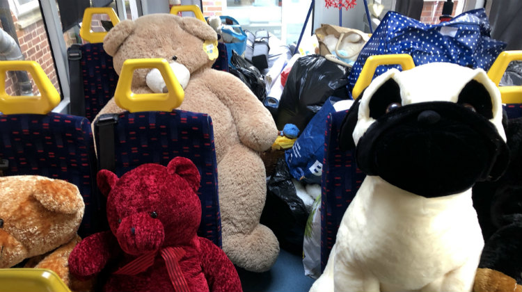 Teddy bears on the seats of a minibus